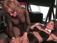 Mistress Nina Hartley has fun with captured lady Deauxma.