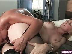 Dominating brunette lesbian chokes Nina sitting on her face.
