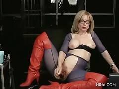 Nina takes her vibrating wand and goes on her masturbating.